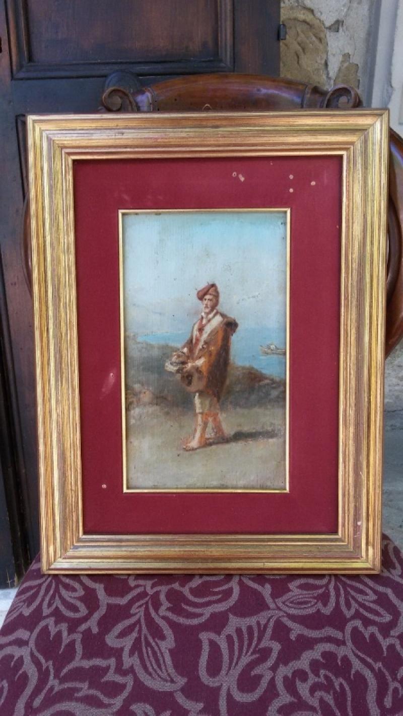 Dipinto olio su tela raffigurante una marina con pescatore, realizzato tra la fine dell'800 e l'inizio del '900, di scuola napoletana.