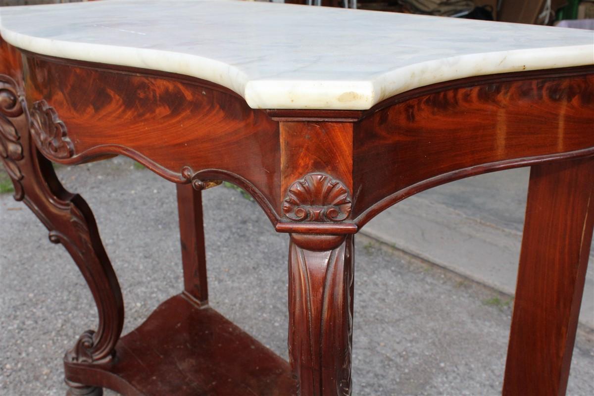 Console in legno di mogano e piano in marmo in buone condizioni realizzata in Francia nell'800.
